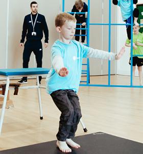 gymnastics boy jump landing 1