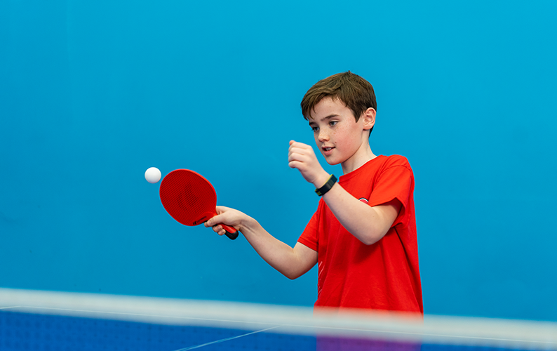 table tennis hits ball