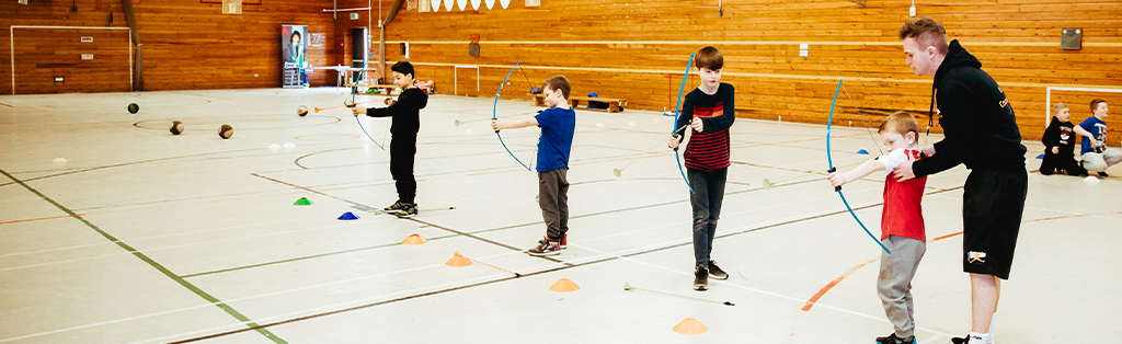 5 ways coaching impact coach children archery 1024x314 1