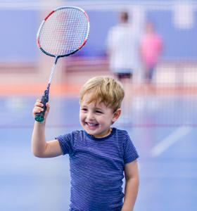 Badminton young boy racket 353x378 1