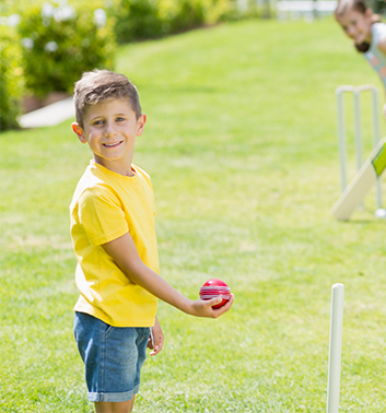 Cricket boy holding ball 353x378 1