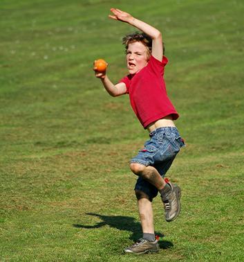 Cricket boy throwing ball red 353x378 1