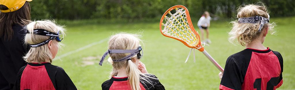 Lacrosse girls watching sport 1024x314 1
