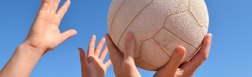 Netball closeup hands ball 1024x314 1