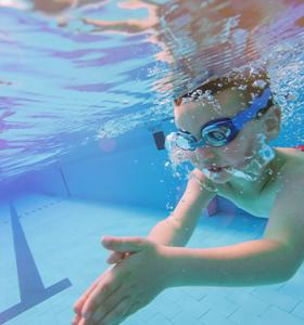 Swimming boy underwater 353x378 1