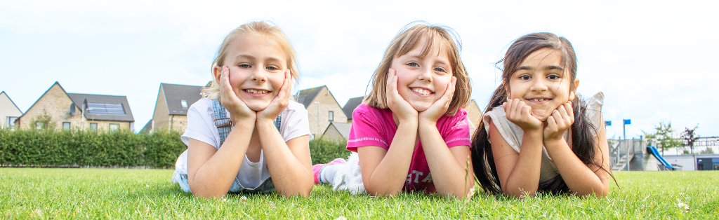Wellbeing girls smiling 1024x314 1