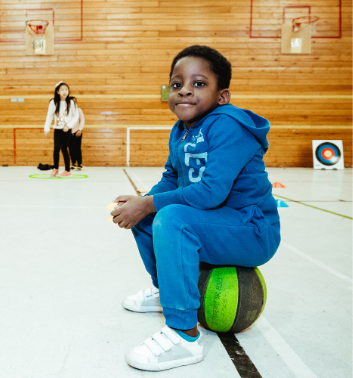 boy sitting basketball