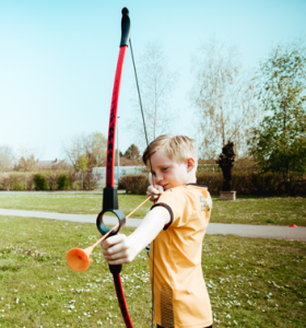 Archery Gallery child aiming bow and arrow