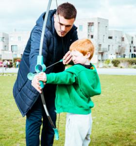 Archery Gallery coach teaching child