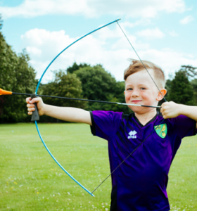 Archery Gallery smiling child with bow and arrow