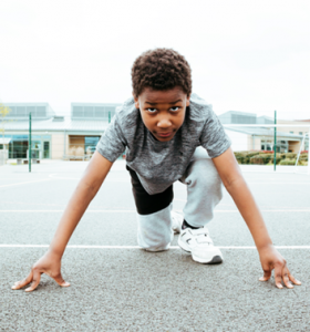 Athletics Gallery child preparing to sprint