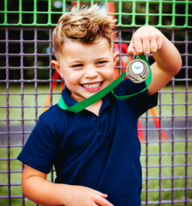 Baseball softball Gallery child holding a medal