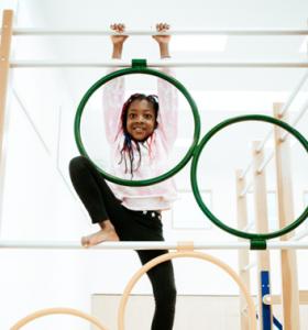 Gymnastics Gallery Child climbing up a frame