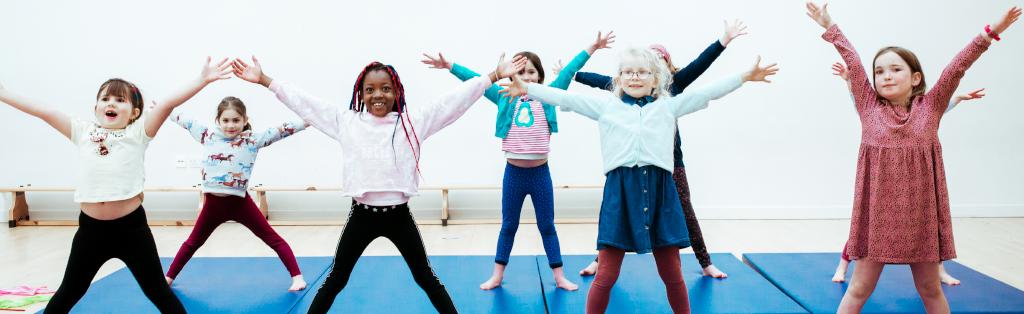 A group of girls enjoy a Premier Education Dance club.