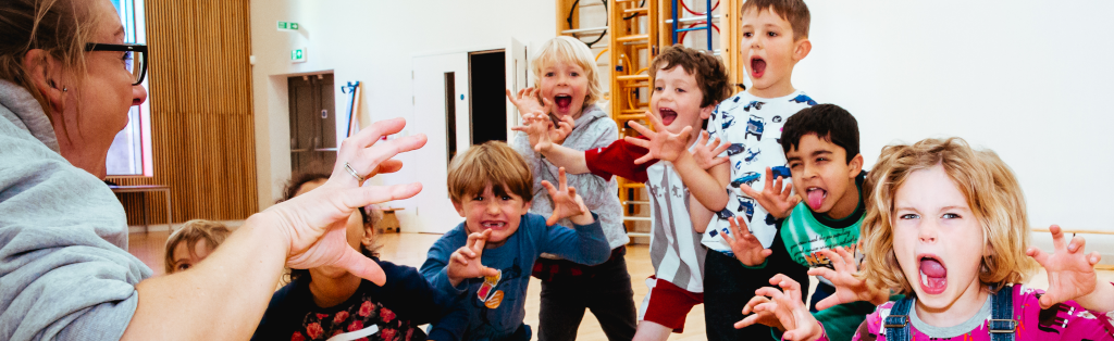 Children posing as part of a drama session at a Premier Education Holiday Camp.