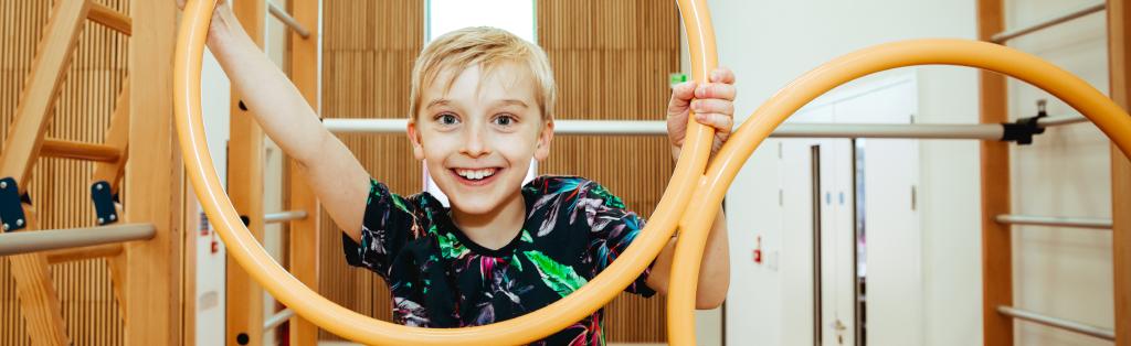 Smiling boy enjoying Premier Education Gymnastics club.
