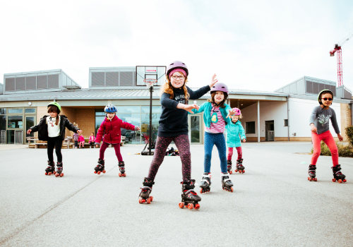 Children rollerskating at a Premier Education Holiday Camp