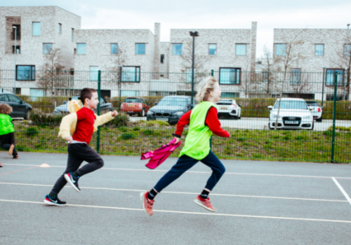 Children playing tag rugby at a Premier Education after-school club